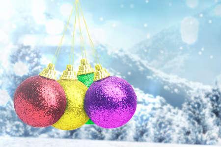 Colorful Christmas ball hanging with snowfall background. Merry Christmas Archivio Fotografico