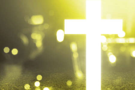 Shiny Christian Cross with blurred light background