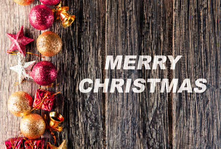 Colorful Christmas ornament on wooden table. Merry Christmas Archivio Fotografico
