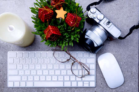 Close up view of millet grass plant in the pot with christmas decoration and the keyboard on the desk