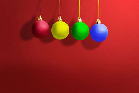 Colorful Christmas ball hanging with a colored background. Merry Christmas Archivio Fotografico