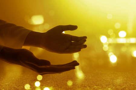 Jesus Christ hand praying to god with blurred light background Archivio Fotografico