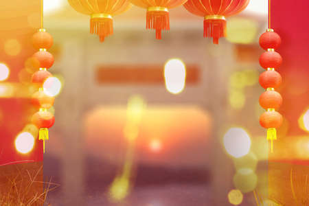 Chinese lanterns hanging with red wall and blurred lights background