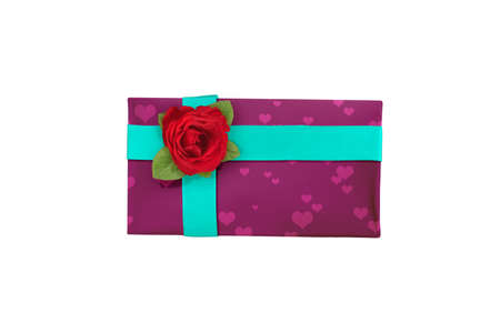 Gift box with ribbon and heart shape with red rose isolated over white background