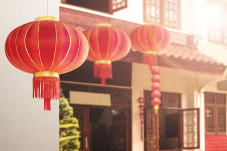 Chinese lanterns hanging in front of the house with the sunlight background