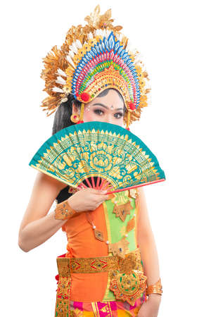 Asian woman dancing Balinese traditional dance isolated over white background