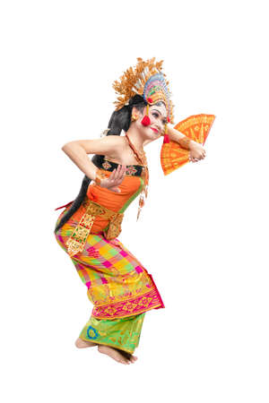 Asian woman dancing Balinese traditional dance isolated over white background Standard-Bild