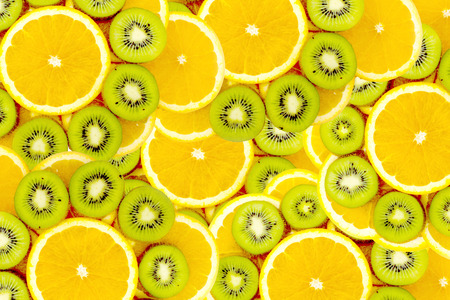 fruity: Fruity background set of slices of orange fruit and kiwi  Many slices of kiwi fruit and orange fruit, Fresh kiwis and orange fruit, interesting fruit composition