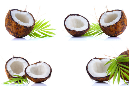 Set of coconuts with leaves isolated on white background photo