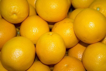 a lot of juicy, ripe oranges closeup. orange background  photo