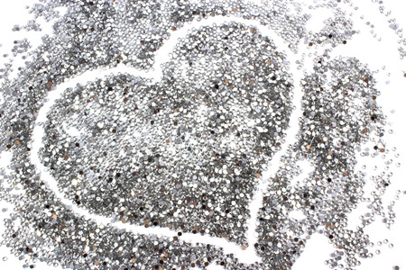glitter silver background with heart. abstract background photo