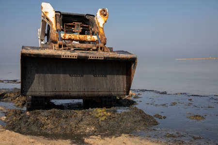 bobcat, works to clean the beach, Skid loader