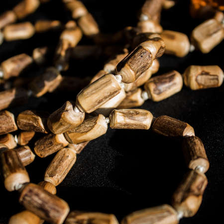 Wooden beads rosary made from the stems of Tulsi. Wooden rosary. Reklamní fotografie