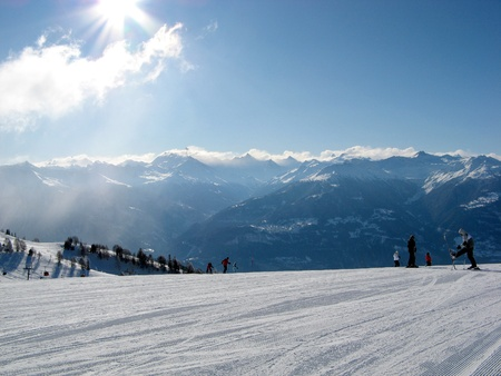 Scenic view of ski slopes in resort of crans montana with mountains in background, valais, switzerland.