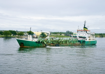 Lagos: old green dredge in lagos harbour Stock Photo