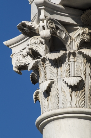 detail of a column in a temple in italy photo