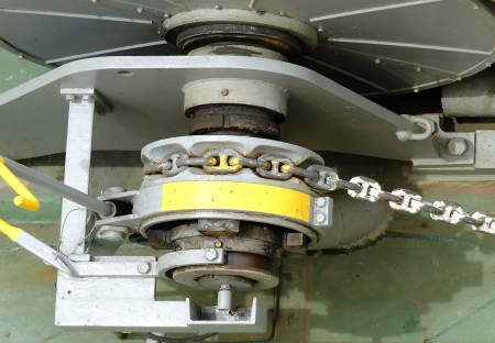 a big ship: winch with chain on board a big ship Stock Photo