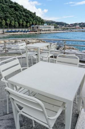 spezia: white table near the beach in san terenzo near lerici