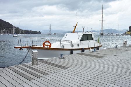 fishing boat in the harbour of le grazie near la spezia photo