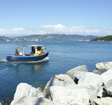 fishing boat in the channel of portovenere , la spezia italy photo