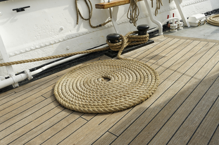 marine rope on top a old ship deck photo