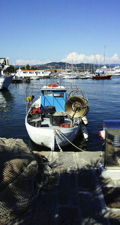 beautiful fishing boat in the harbour of la spezia photo