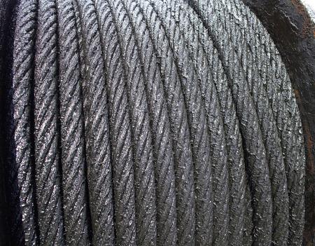 sludge: steel wire rope with sludge, closeup of photo