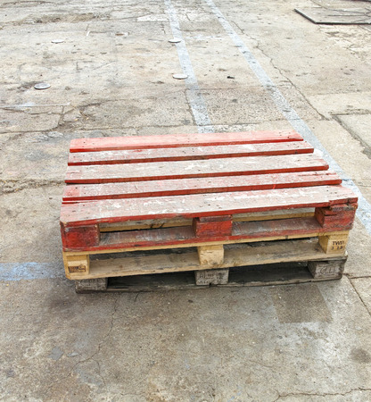 old wooden shipping pallet in a shipyard photo
