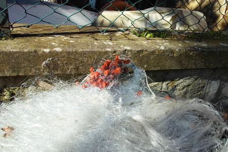 fishingnet: fishing net in a harbour located ib trasimeno lake