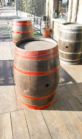 Vintage style barrels against a wall in la spezia photo