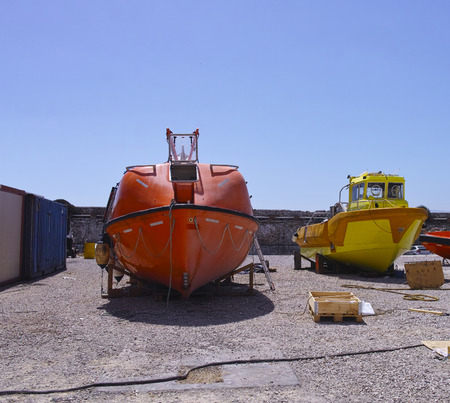 lifeboat: lifeboat and patrol boat in a shipyard
