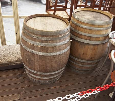 wooden barrels in a street in la spezia photo