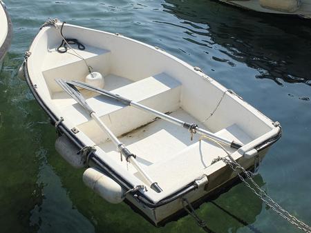 spezia: white little boat in the harbour of la spezia