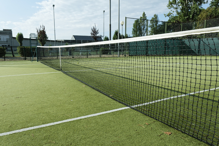 green tennis court in the town of la spezia Stock Photo