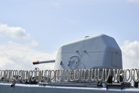 firepower: detail of military cannon on top a military ship