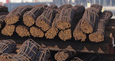 corode: Plenty steel bar ready in a harbour Stock Photo
