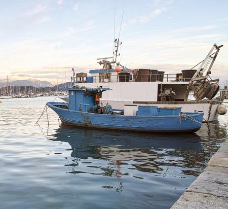 spezia: blue fishing boat in the harbour of la spezia