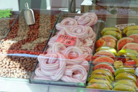 sugarcoat: plenty candy at market in the town of la spezia