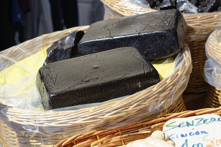 licorice: detail of pure licorice blocks at market
