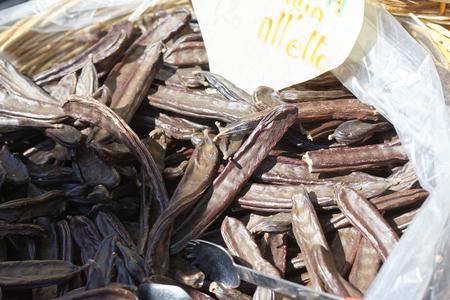 carob: detail of carob inside a sack