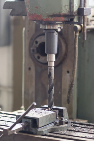 industrial iron drill in a italian factory