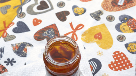 Sun dried tomatoes with olive oil in a jar in my house