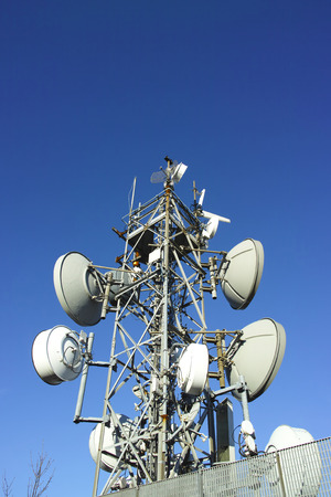 detail of telecomunication tower against blue sky Stock Photo