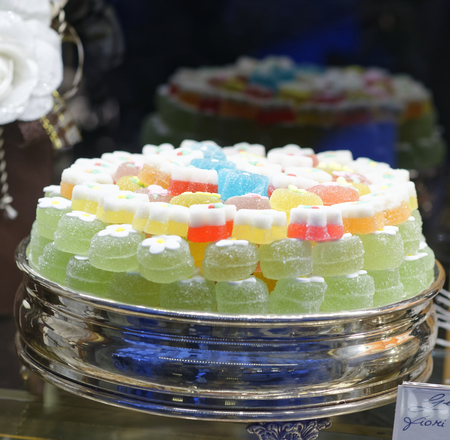 detail of many colorful fruit gelatin in a pastry