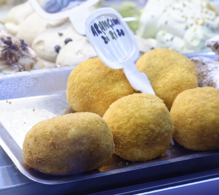 detail of arancini at market in italy Stock Photo
