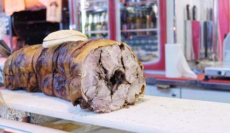 a italian porchetta at market in italy Standard-Bild