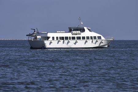 detail of white ferry boat in the gulf of la spezia