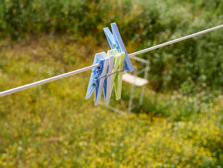 Clothes pegs on the washing line in my house Stock Photo