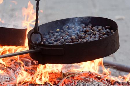 Cooking chestnuts on burning coals in calice al cornoviglio