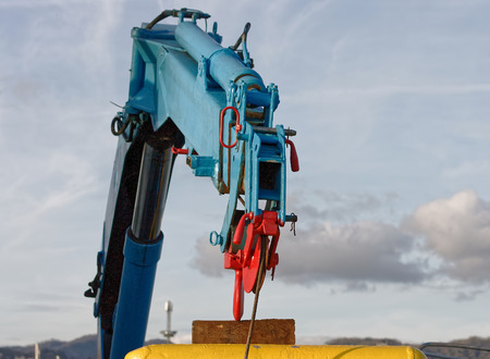 detail of hydraulic crane on a fishing vessel in a harbour Stock Photo